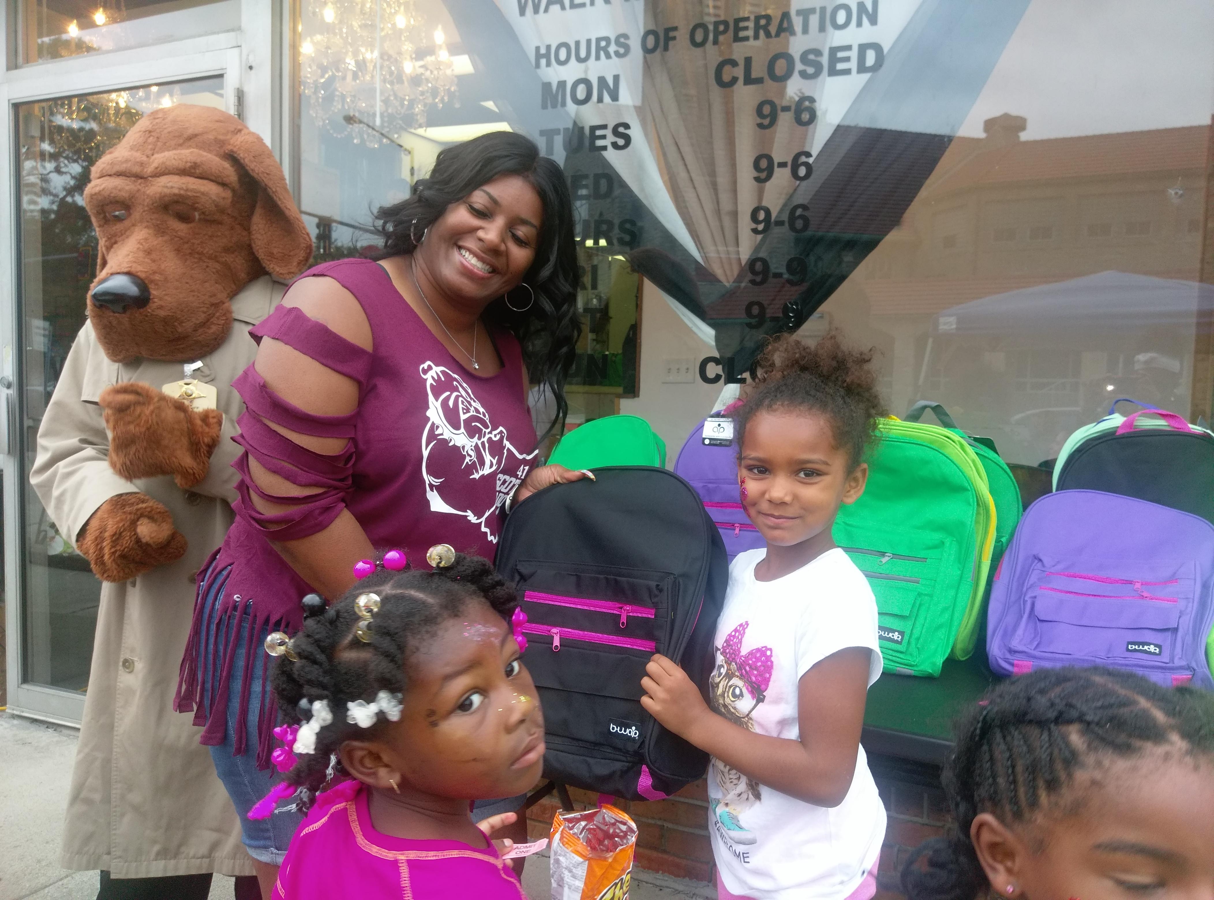 CHW_Bookbag-Haircut Event_Child Bookbag McGruff_Elegant Beauty_August 2016